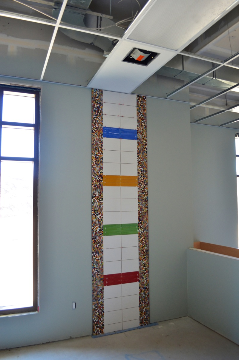 A tile accent on the wall of the nursery