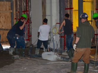 The first bit of concrete being poured